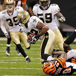 2009 August 14: New Orleans Saints cornerback Malcolm Jenkins (27) hits Cincinnati Bengals wide receiver Jerome Simpson (89) forcing the ball into the air where it was intercepted by linebacker Jonathan Casillas (62) during 17-7 win by the New Orleans Saints over the Cincinnati Bengals in their preseason opener at the Louisiana Superdome in New Orleans, Louisiana.