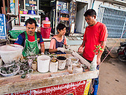 20 JUNE 2014 - SAMUT SAKHON, SAMUT SAKHON, THAILAND: Burmese betel nut vendors sell betel to Burmese migrants in Samut Sakhon. Hundreds of thousands of migrant workers from Myanmar work in the Thai fishing industry. Samut Sakhon, (sometimes still called Mahachai, its historical name) is a large fishing port. Many Burmese live in the town and work in the fish process plants. Although hundreds of thousands of Cambodians fled Thailand last week after the military coup, the Burmese workers have stayed and are still working in many Thai towns.    PHOTO BY JACK KURTZ