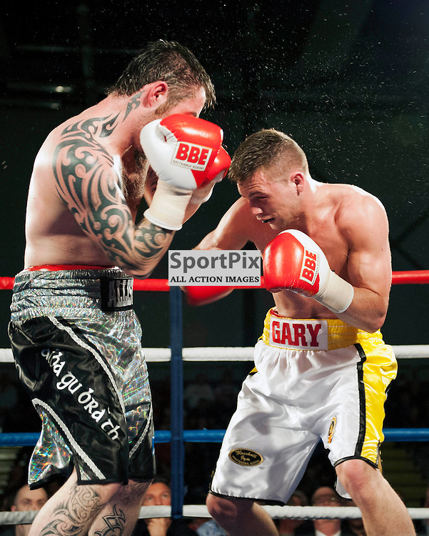Gary McCallum beats Paul Allison to win the Scottish Middleweight Title. Gary McCallum v Paul Allison, Scottish Middleweight Championship Fight, Ravenscraig Sports Facility, Friday 8 March 2013 ANGIE ISAC | StockPix.eu