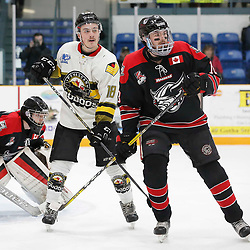 TRENTON, ON  - MAY 5,  2017: Canadian Junior Hockey League, Central Canadian Jr. &quot;A&quot; Championship. The Dudley Hewitt Cup. Game 7 between The Georgetown Raiders and The Powassan Voodoos. Matthew Thom #18 of the Georgetown Raiders and  Brett Hahkala #18 of the Powassan Voodoos battle for position during the first period <br /> (Photo by Amy Deroche / OJHL Images)