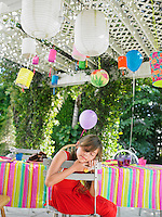 Young girl (7-9) sleeping at table after birthday party