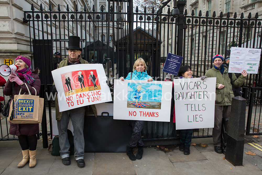 London, UK. 21st November, 2018. Pro-Brexit activists protest outside Downing Street on the day on which Prime Minister Theresa May is scheduled to travel to Brussels to attend discussions with Jean-Claude Juncker, President of the European Commission, regarding a political declaration to accompany the withdrawal agreement.