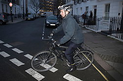 © Licensed to London News Pictures. 10/01/2017. London, UK. Health Secretary Jeremy Hunt leaves home by bicycle before attending Cabinet. Mr Hunt has faced criticism after suggesting patients at accident and emergency units, with less serious problems, may no longer be guaranteed to be seen in four hours. Photo credit: Peter Macdiarmid/LNP