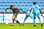 Forest Green Rovers Tahvon Campbell(14) gets pulled back by Coventry City defender Dominic Hyam (15)  during the EFL Trophy match between Coventry City and Forest Green Rovers at the Ricoh Arena, Coventry, England on 9 October 2018.
