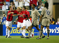 Photo Aidan Ellis.<br />Manchester United v Barcelona (at the Lincoln Financial Field Philadelphia) 03/08/03.<br />United's Diego Forlan is congratualted by team mates Nicky Butt and Roy Keane after equalising for his team whilst Barcelona's Ronaldinho looks on