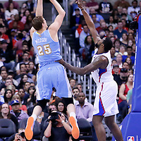 15 April 2014: Denver Nuggets center Timofey Mozgov (25) takes a jump shot over Los Angeles Clippers center DeAndre Jordan (6) during the Los Angeles Clippers 117-105 victory over the Denver Nuggets at the Staples Center, Los Angeles, California, USA.