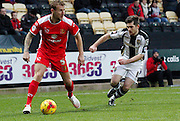 Kyle McFadzean and Ronan Murray during the Sky Bet League 1 match between Notts County and Milton Keynes Dons at Meadow Lane, Nottingham, England on 26 December 2014. Photo by Jodie Minter.