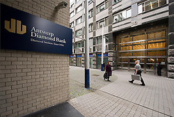 A security guard carrying a case, walks past the Antwerp Diamond Bank on Hoveniersstraat, in the heart of the diamond district, in Antwerp, Belgium, on Thursday, Oct. 22, 2009. (Photo © Jock Fistick)