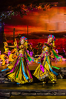 A massive stage show featuring song and dance performances and ornate traditional costumes, Shangri-La (Zhongian), Yunnan Province, China.