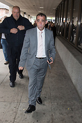 © Licensed to London News Pictures . 02/09/2013 . Manchester , UK . MICHAEL LE VELL (aka Michael Turner ) , who plays Kevin Webster in Coronation Street , takes a cigarette break during the first day of his trial today (2nd September 2013). He is charged with a series of offences including rape , sexual activity with a child and indecent assault . Photo credit : Joel Goodman/LNP