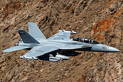 United States Navy Boeing EA-18G Growler (side 503) from the VX-31 Dust Devils squadron flies low level on the Jedi Transition through Star Wars Canyon / Rainbow Canyon, Death Valley National Park, Panamint Springs, California, United States of America