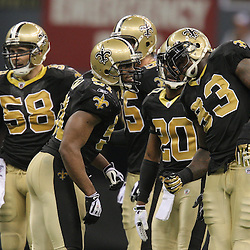 Jan 24, 2010; New Orleans, LA, USA; New Orleans Saints linebacker Jonathan Vilma (51) talks to teammates in a defensive huddle during a 31-28 overtime victory by the New Orleans Saints over the Minnesota Vikings in the 2010 NFC Championship game at the Louisiana Superdome. Mandatory Credit: Derick E. Hingle-US PRESSWIRE