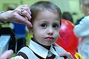 "Shalev, Young Jewish boy of three having his first ritual haircut called Upsherin (Yiddish: lit. ""shear off"") or Chalaka"