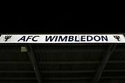 AFC Wimbledon illuminated sign during the EFL Trophy group stage match between AFC Wimbledon and Stevenage at the Cherry Red Records Stadium, Kingston, England on 6 November 2018.
