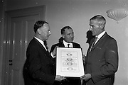 16/08/1967<br /> 08/16/1967<br /> 16 August 1967<br /> Presentation of new Fishery Standards Licence at the Shelbourne Hotel, Dublin. Image shows Dr. Arthur Hughes, Chairman of the Institute for Industrial Research and Standards (left) presenting Mr. P.J.Hardy, Managing Director of Seaborn Ltd., Dublin, with the first licence issued under the new fishery standards prepared by the Institute. Centre is the Chairman of Bord Iascaigh Mhara/Irish Sea Fisheries Board, Mr. Brendan O'Kelly.