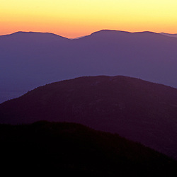 from East Horn, Bigelow Mountain, ME. Appalachian Trail. Northern Forest. The sun sets behind the Boundary Mtns.