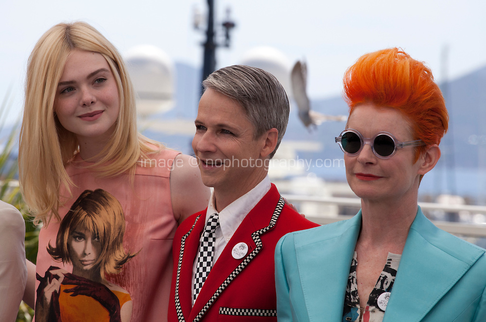 Actress Elle Fanning, director Cameron Mitchell and designer  Sandy Powell at the How To Talk To Girls At Parties film photo call at the 70th Cannes Film Festival Sunday 21st May 2017, Cannes, France. Photo credit: Doreen Kennedy
