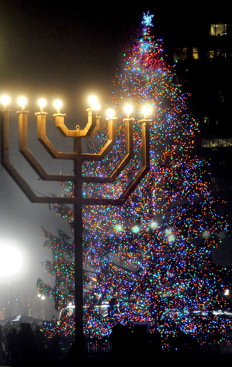 (Mara Lavitt &mdash; New Haven Register) <br /> December 5, 2013 New Haven<br /> A Chanukah menorah remained lit for the annual New Haven city tree lighting event on the Green.