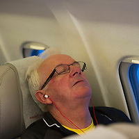 Rosenborg v St Johnstone....18.07.13  UEFA Europa League Qualifier.<br /> Tommy Campbell sleeps the flight home from Trondheim <br /> Picture by Graeme Hart.<br /> Copyright Perthshire Picture Agency<br /> Tel: 01738 623350  Mobile: 07990 594431