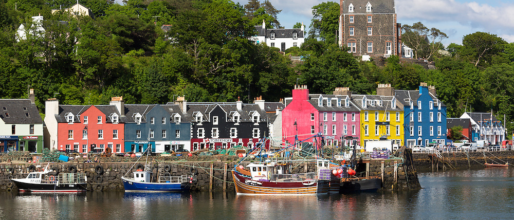 Multi-coloured buildings on the waterfront at Tobermory the capital city of the Isle of Mull in the Inner Hebrides of Scotland