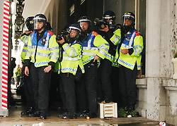 © under license to London News Pictures.  26/03/11 Police under attack from anarchists outside the Ritz at the massive Anti-cuts march in London. Photo credit should read: Olivia Harris/ London News Pictures