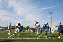 Virginia head coach Al Groh watches Virginia running back Keith Payne (32) during a drill.  The Virginia Cavaliers football team during an open practice on August 16, 2008 at the University of Virginia's football turf field in Charlottesville, VA.