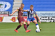 Queens Park Rangers Defender, Jake Bidwell (3) and Wigan Athletic Midfielder, Max Power (6) during the EFL Sky Bet Championship match between Wigan Athletic and Queens Park Rangers at the DW Stadium, Wigan, England on 27 August 2016. Photo by Mark Pollitt.