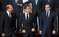 "Nicolas Sarkozy, France's president, center, , prepares for the ""Family Photo"" session with Traian Basescu, Romania's president, left, and François Fillon, France's prime minister, right, at the European Summit, in Brussels, Belgium, Wednesday, Oct. 15, 2008.   (Photo © Jock Fistick)"