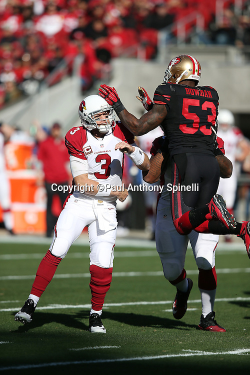 Arizona Cardinals quarterback Carson Palmer (3) throws an incomplete first quarter pass due to pressure from leaping San Francisco 49ers inside linebacker NaVorro Bowman (53) who blitzes on the play during the 2015 week 12 regular season NFL football game against the San Francisco 49ers on Sunday, Nov. 29, 2015 in Santa Clara, Calif. The Cardinals won the game 19-13. (©Paul Anthony Spinelli)