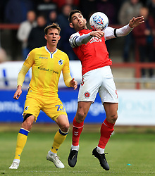 Ched Evans of Fleetwood Town chests the ball under pressure from Joe Partington of Bristol Rovers - Mandatory by-line: Matt McNulty/JMP - 27/04/2019 - FOOTBALL - Highbury Stadium - Fleetwood, England - Fleetwood Town v Bristol Rovers - Sky Bet League One
