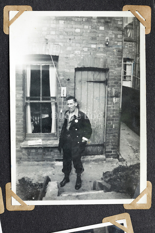 adult male person posing in front of house