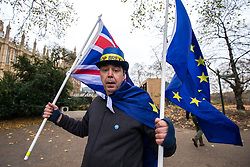 © Licensed to London News Pictures. 05/12/2017. London, UK. An anti-brexit protester in Victoria Gardens as Nigel Dodds MP, Deputy Leader of the DUP, speaks to the media after Prime Minister Theresa May failed to secure a Brexit deal in Brussels on Monday 4 December 2017. Photo credit: Rob Pinney/LNP