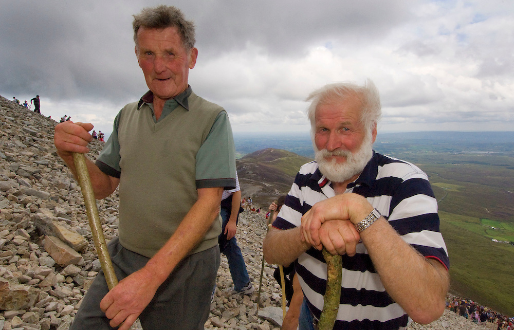 74 year old Paddy Hickey fromKilkenny with his nephew John Holohan as they make their way up the shoulder of Irelands Holy Mountain, Croagh Patrick, Co. Mayo. Pic: Michael Mc Laughlin Thousands of Pilgrims make their way up and down Croagh Patrick, Irelands Holy Mountain on the annual the pilgrimage day which fall on the second weekend of July, Murrisk Co. Mayo. Pic: Michael Mc Laughlin Thousands of Pilgrims make their way up and down Croagh Patrick, Irelands Holy Mountain on the annual the pilgrimage day which fall on the second weekend of July, Murrisk Co. Mayo. Pic: Michael Mc Laughlin