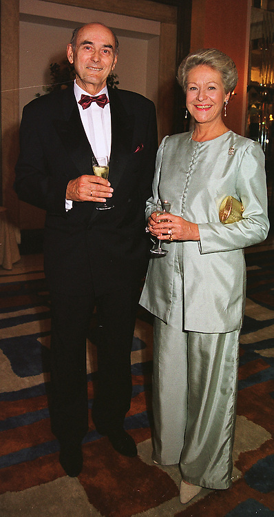 PRINCE & PRINCESS DIMITRI ROMANOV at a reception in London on 19th June 1999.MTL 2