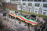 Frankfurt | 18 March 2017<br /> <br /> Am Samstag (18.02.2017) feierten &uuml;ber 30000 Kurden im Rahmen einer Demonstration das kurdische Neujahrsfest Newroz, bei der Demo sprachen sie sich gegen eine Diktatur und f&uuml;r die Freilassung von PKK-F&uuml;hrer Abdullah &Ouml;calan aus.<br /> Hier: Demonstranten tragen bei der Demo auf der Mainzer Landstra&szlig;e eine riesige Fahne in den kurdischen Farben gelb-rot-gr&uuml;n.<br /> <br /> photo &copy; peter-juelich.com<br /> <br /> Nutzung honorarpflichtig!