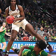 March 31, 2019; Portland, OR, USA; Oregon Ducks forward Ruthy Hebard (24) falls between the legs of Mississippi State Bulldogs center Teaira McCowan (15) in the Elite Eight of the NCAA Women's Tournament at Moda Center.<br /> Photo by Jaime Valdez