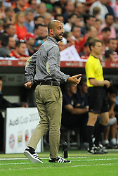 01.08.2013, Allianz Arena, Muenchen, Audi Cup 2013, FC Bayern Muenchen vs Manchester City, im Bild, Trainer Pep GUARDIOLA (FC Bayern Muenchen) gibt Anweisungen. Freisteller, Ganzkoerper, Ganzfigur, Einzelaktion, hoch , hochformat, vertikal, Aktion,  // during the Audi Cup 2013 match between FC Bayern Muenchen and Manchester City at the Allianz Arena, Munich, Germany on 2013/08/01. EXPA Pictures © 2013, PhotoCredit: EXPA/ Eibner/ Wolfgang Stuetzle<br /> <br /> ***** ATTENTION - OUT OF GER *****