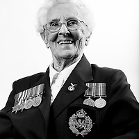 Ena Day, WAAF, 1942-1946, RT Operator, WW2 Veteran, Veterans Portrait Project UK, Eastbourne, England. n the late 1930s Ena was a government telephone exchange operator. However, desperate to actively serve her country during the Second World War, she volunteered to join the Women&rsquo;s Auxiliary Air Force in 1942.<br /> <br /> She trained as a Direction Finding Operator at RAF Hawkinge in Kent. She was stationed here on D-Day and remembers the day well. Although it was obvious that something big was happening, they all just got on with their jobs.<br /> <br /> Ena was later posted to RAF Manston, where she contributed to the air war until the war ended. Leaving the RAF in February 1946 Ena joined the WAAF Association and the RAF Association and has remained dedicated to furthering the aims of both these Associations ever since. Her husband went to Normandy as part of the RAF Second Tactical Air Force. Even the men on the ground didn&rsquo;t know where they were going beforehand. He was on Sword Beach and being of the era where people didn&rsquo;t talk about their experiences too much, simply described the scene as &lsquo;terrible&rsquo;.  Ena went to great lengths to point out that she is 95 years young!!!