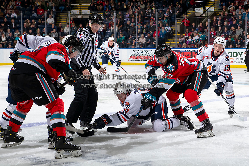 KELOWNA, BC - OCTOBER 12: Connor Zary #18 of the Kamloops Blazers digs for the puck after the face-off against Alex Swetlikoff #17 of the Kelowna Rockets at Prospera Place on October 12, 2019 in Kelowna, Canada. (Photo by Marissa Baecker/Shoot the Breeze)