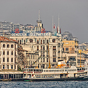 A ferry docked in front of the old waterfront of Beyoglu on the Golden Horn in Istanbul, Turkey.