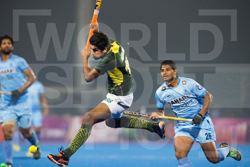 BHUBANESWAR (India) -  Hero Champions Trophy hockey men. Semifinal India vs Pakistan. Muhammad Arlsan Qadir of Pakistan (m) and right Birendra Lakra of India. Photo Koen Suyk