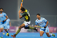 BHUBANESWAR (India) -  Hero Champions Trophy hockey men. Semifinal India vs Pakistan. Muhammad Arlsan Qadir of Pakistan (m) and right Birendra Lakra of India. Photo Koen Suyk