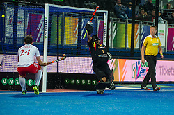 Spain's Fancisco Cortes can't keep Ashley Jackson's penalty corner shot out and England go one up. England v Spain - Unibet EuroHockey Championships, Lee Valley Hockey & Tennis Centre, London, UK on 25 August 2015. Photo: Simon Parker