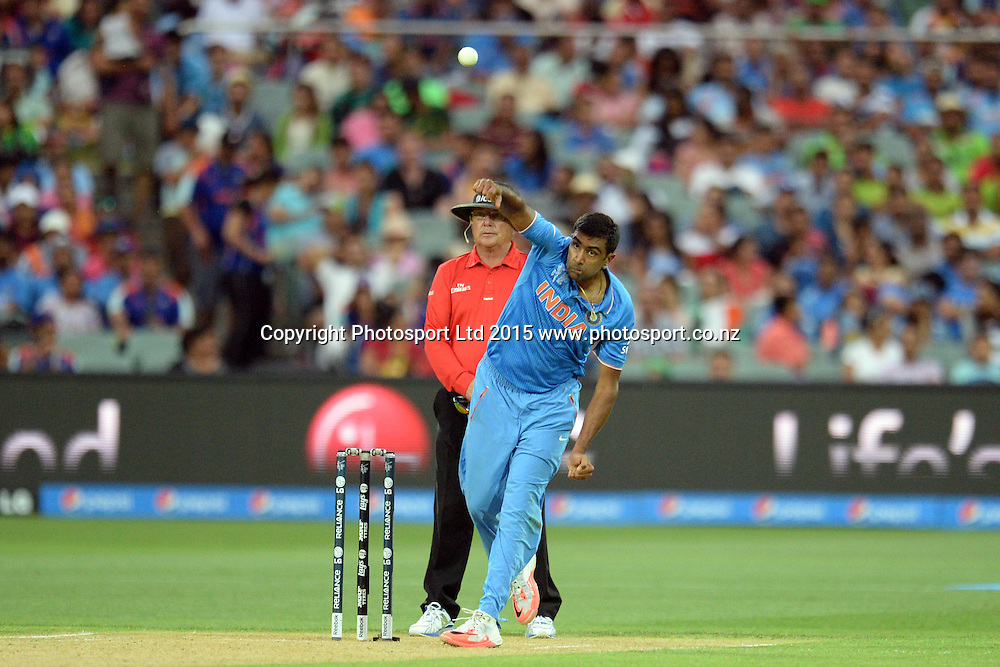 Indian bowler Ravichandran Ashwin into his delivery stride during the ICC Cricket World Cup match between India and Pakistan at Adelaide Oval in Adelaide, Australia. Sunday 15 February 2015. Copyright Photo: Raghavan Venugopal / www.photosport.co.nz