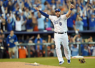 Oct 15, 2014; Kansas City, MO, USA; Kansas City Royals infielder Mike Moustakas (8) celebrates after defeating the Baltimore Orioles in game four of the 2014 ALCS playoff baseball game at Kauffman Stadium. The Royals swept the Orioles to advance to the World Series. Mandatory Credit: Peter G. Aiken-USA TODAY Sports