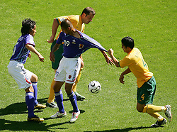 FIFA World Cup 2006 Tsuneyasu Miyamoto and Keisuke Tsuboi of Japan battle for the ball with Mark Viduka and Tim Cahill of Austrialia