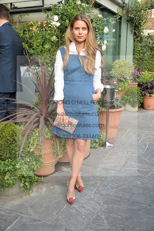 IRENE FORTE at a party to celebrate 'A Year In The Garden' celebrating the first year of The Ivy Chelsea Garden, 197 King's Road, London on 16th May 2016.