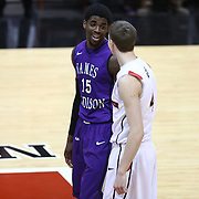 Andre Nation #15 of the James Madison University Dukes speaks with David Walker #4 of the Northeastern Huskies during the game at Matthews Arena on January 29, 2014 in Boston, Massachusetts . (Photo by Elan Kawesch)