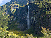 A waterfall plunges in Rob Roy Valley, Mount Aspiring National Park, Southern Alps, South Island, New Zealand. In 1990, UNESCO honored Te Wahipounamu - South West New Zealand as a World Heritage Area.