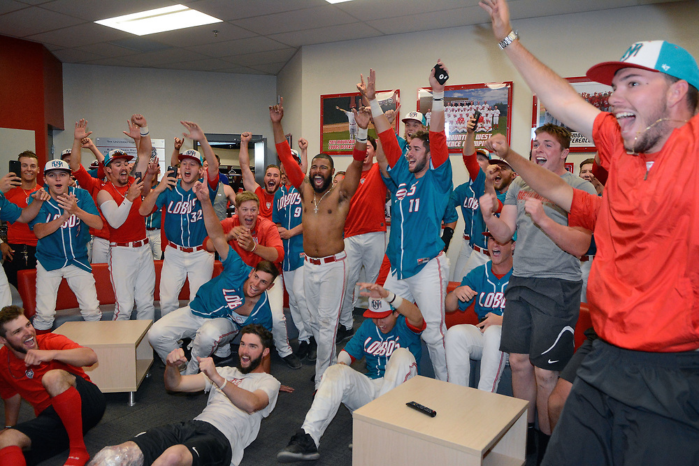 jt052017p/ sports/jim thompson/UNM baseball players celebrate the final out of the Fresno St. beating  San Diego St.on TV giving the Lobos the Mountain West Championship after their 13-6 win over Nevada. Saturday May. 20, 2017. (Jim Thompson/Albuquerque Journal)